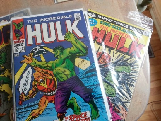 Stack Annuals and over-size special editions at the bottom of the same hero's stack.