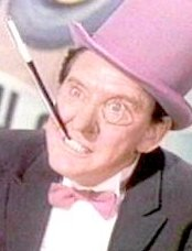 Burgess Meredith stars as the Penguin, a posh, umbrella-obsessed bad guy in the Batman TV series
