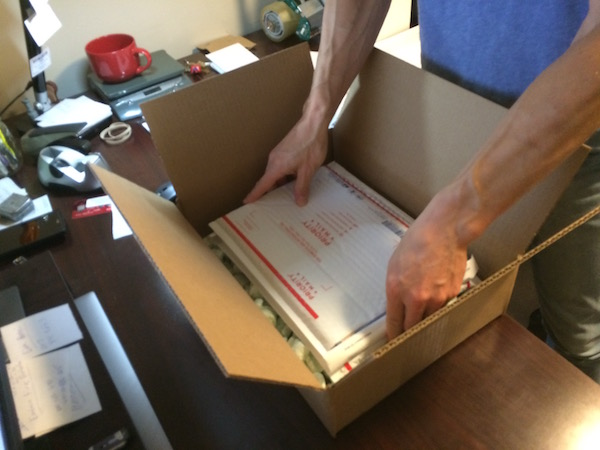 Shipping CGC comics: lay the books on top of the layer of padding